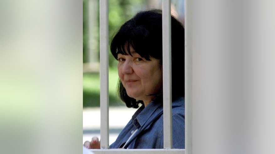 FILE - In this June 27, 2001, file photo Mirjana Markovic, the wife of former Yugoslav President Slobodan Milosevic, arrives to visit Milosevic at the central prison in Belgrade, Serbia. Slobodan Milosevic's exiled widow has ridiculed European Union's decision to lift a 15-year freeze on assets of the former Serbian strongman, saying that the family has no property outside Serbia. (AP Photo/Darko Vojinovic, File)