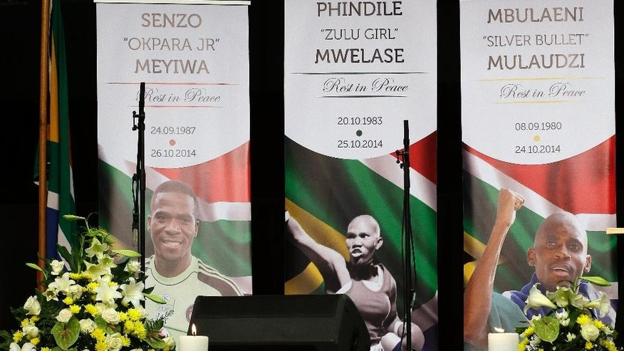 Banners at a memorial service for three South African sports figures who died within days of each other at an indoor sports arena in downtown Johannesburg, South Africa, Thursday, Oct. 30, 2014. South Africa's sport ministry organized a combined memorial service for fans of national soccer captain and goalkeeper Senzo Meyiwa, Olympic silver medalist Mbulaeni Mulaudzi and welterweight boxer Phindile Mwelase. (AP Photo/Themba Hadebe)