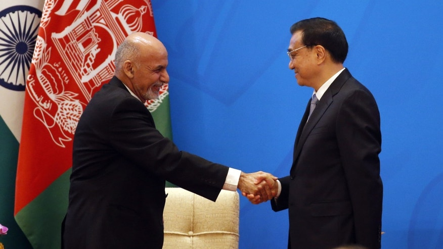 Chinese Premier Li Keqiang, right, shakes hands with Afghan President Ashraf Ghani Ahmadzai at opening ceremony of the 4th Ministerial Conference of Istanbul Process of Afghanistan.