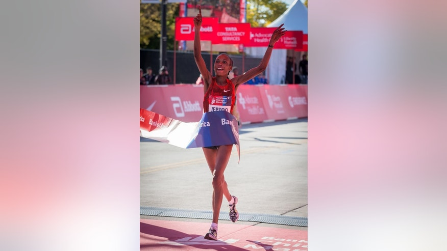 FILE - This Oct. 12, 2014, file photo, Rita Jeptoo of Kenya crosses the finish line to win the women's race at the Chicago Marathon in Chicago. The agent Rita Jeptoo said Friday, Oct. 31, 2014 that the Kenyan runner has failed a doping test. (AP Photo/Andrew A. Nelles, File)