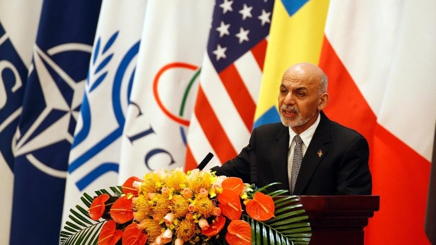 Afghan President Ashraf Ghani Ahmadzai delivers his speech at the opening ceremony of the 4th Ministerial Conference of Istanbul Process of Afghanistan, at the Diaoyutai State Guesthouse in Beijing, China Friday, Oct. 31, 2014. (AP Photo/Takaki Yajima, Pool)