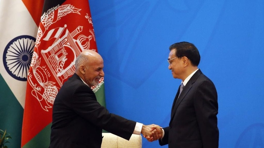 Chinese Premier Li Keqiang, right, shakes hands with Afghan President Ashraf Ghani Ahmadzai  at opening ceremony of the 4th Ministerial Conference of Istanbul Process of Afghanistan, at the Diaoyutai State Guesthouse in Beijing, China Friday, Oct. 31, 2014. (AP Photo/Takaki Yajima, Pool)