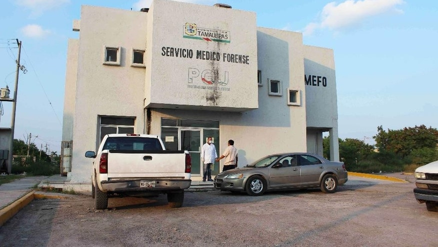 """The exterior of Mexico's Medical Forensic Service (SEMEFO) where the bodies of three U.S. citizens are being held in Matamoros, Mexico, Friday, Oct. 29, 2014. Authorities are investigating a possible police connection to the killing of three U.S. citizens visiting their father in Mexico who were found shot to death along with a Mexican friend more than two weeks after going missing. Parents of the three siblings, whose bodies were identified Thursday, have said witnesses reported they were seized by men dressed in police gear calling themselves """"Hercules,"""" a tactical security unit in the violent border city of Matamoros wracked by cartel infighting. (AP Photo/Christopher Sherman)"""