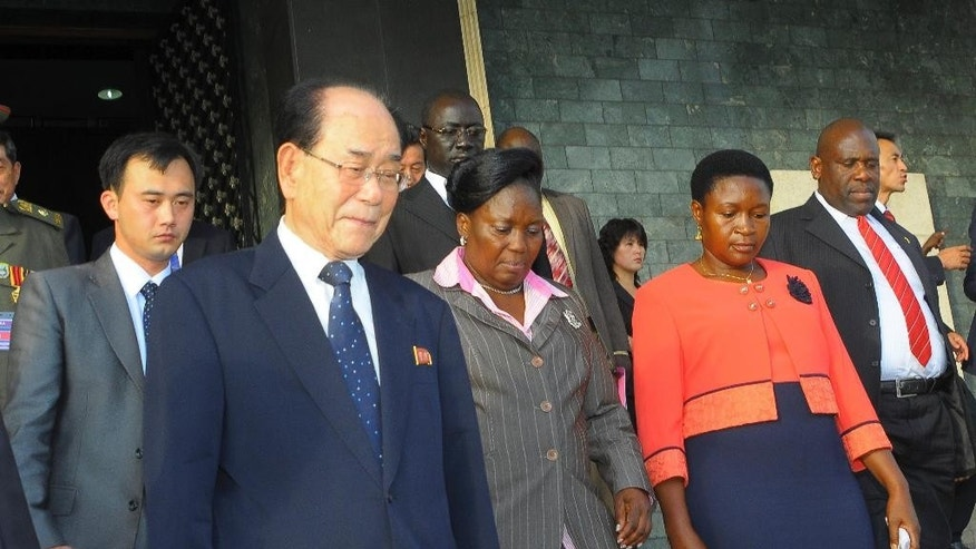 In this photo taken Thursday, Oct. 30, 2014, North Korea's ceremonial leader  Kim Yong Nam, foreground-left, the head of North Korea's parliament, is escorted into Uganda's parliament by its Speaker Rebecca Kadaga, center, Commissioner Rosemary Seninde, center-right, and Uganda's Foreign Affairs Minister Asuman Kiyingi, right, in Kampala, Uganda. Kim Yong Nam is visiting Uganda as part of a rare tour of Africa, where North Korea has actively tried to find allies like the long-serving Ugandan President Yoweri Museveni, who gave a state dinner late Thursday in honor of Kim Yong Nam and commended the Pyongyang government as a symbol of the fight against what he called Western Imperialism. (AP Photo)