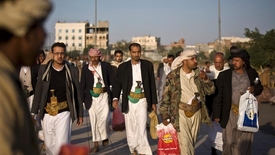 Yemenis leave a tribal meeting held by Houthi Shiite rebels in Sanaa, Yemen, Friday, Oct. 31, 2014. Yemen's Shiite rebels, who are in control of the capital, gave President Abed Rabbo Mansour Hadi 10 days starting Friday to form a government, hinting at a takeover attempt if their demands are not met. (AP Photo/Hani Mohammed)