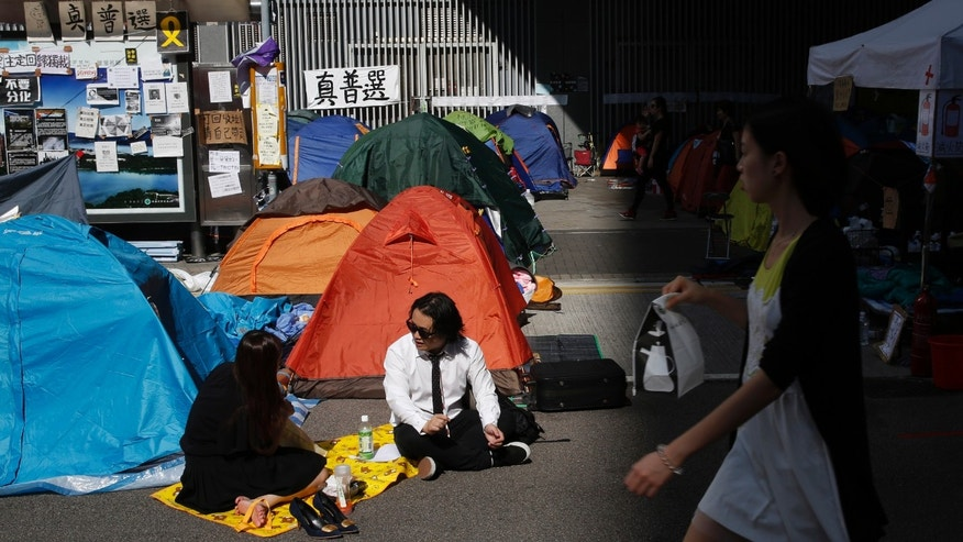 Oct. 29, 2014: Pro-democracy protesters have lunch in the occupied areas outside government headquarters in Hong Kong's Admiralty