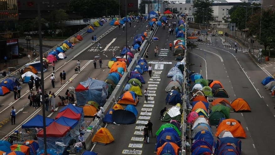 In this Wednesday, Oct. 29, 2014 photo, pro-democracy protesters camp in the occupied areas outside government headquarters in Hong Kong's Admiralty. Even as protesters remain locked in a weeks-long stalemate with city officials over demands for electoral reforms, political analysts say this 7.2 million-person financial capital could be seeing the birth of a newly awakened generation that will continue demanding democracy and take to the streets to push for it. (AP Photo/Kin Cheung)
