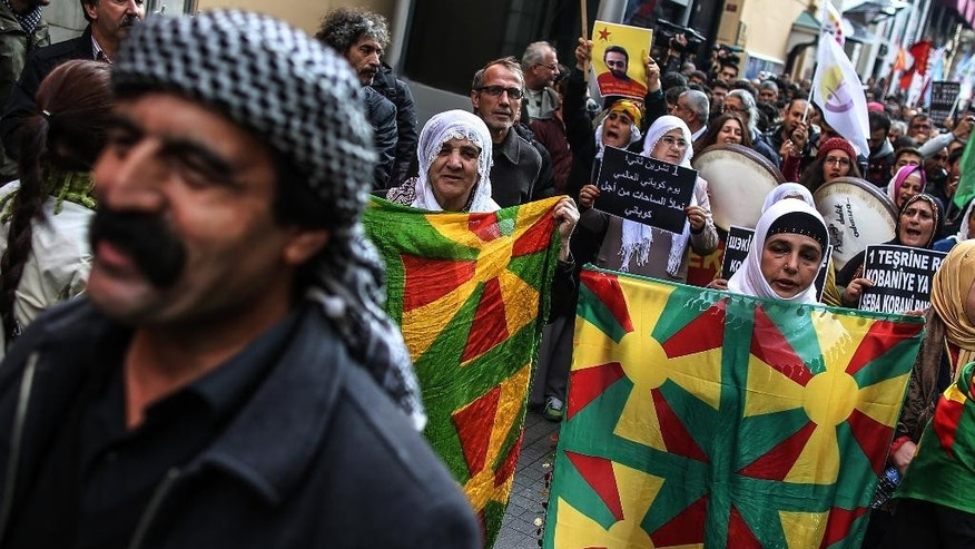 Turkish Kurds march during a rally to support Syrian Kurds fighting Islamic State extremists in the embattled Syrian border town of Kobani or Ayn al-Arab, in Istanbul, Turkey, Saturday, Nov. 1, 2014. (AP Photo/Emrah Gurel)