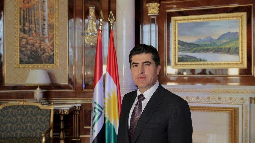 "Nechervan Barzani, prime minister of Iraq's semi-autonomous Kurdish region, poses for a photo during an interview with The Associated Press in Irbil, Iraq, Sunday, Nov. 2, 2014. Barzani said Iraqi Kurdish forces will only stay in Syria ""temporarily"" as they seek to help defend the city of Kobani from militants with the Islamic State group. (AP Photo/Bram Janssen)"