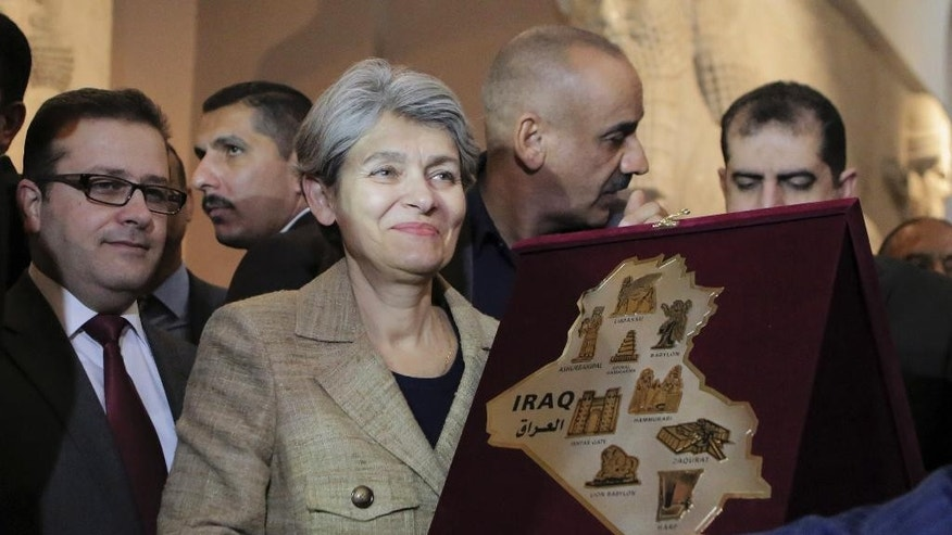 Irina Bokova, the director-general of the United Nations Educational, Scientific and Cultural Organization (UNESCO), receives a plaque at the Iraqi National Museum in Baghdad, Iraq, Sunday, Nov. 2, 2014. (AP Photo/Khalid Mohammed)