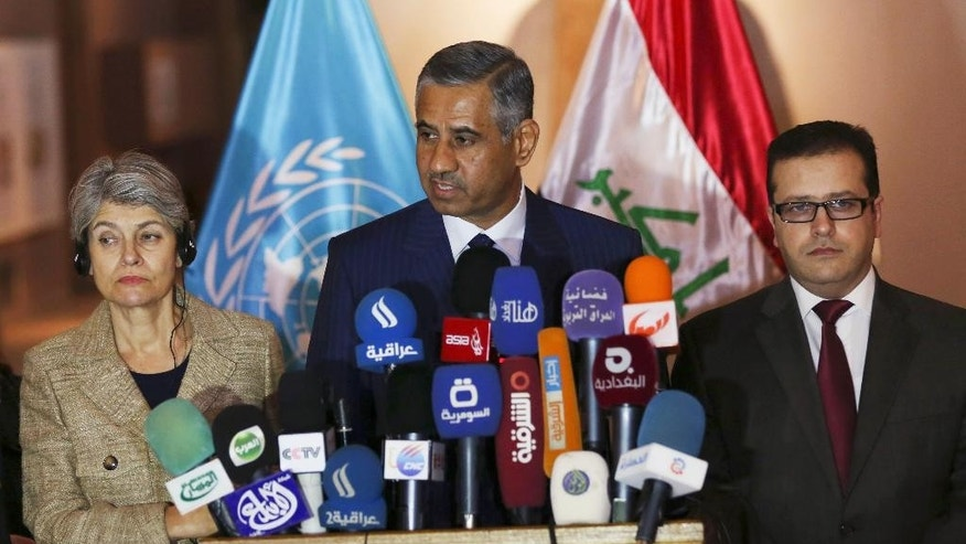 Adel Fahd, center, Iraqi minister of tourism and antiquities, speaks as Mohammed Iqbal, right, Iraq minister of education, and Irina Bokova, the director-general of the United Nations Educational, Scientific and Cultural Organization (UNESCO), listen during a press conference at the Iraqi National Museum in Baghdad, Iraq, Sunday, Nov. 2, 2014. (AP Photo/Khalid Mohammed)