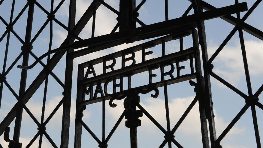 "FILE - In this April 24, 2009 file photo the entrance gate of the former Nazi concentration camp in Dachau near Munich, southern Germany, is pictured with the slogan reading ""Work sets you free"". Police said in a statement Sunday, Nov. 2, 2014, that security officials noticed early Sunday the gate section measuring 190 by 95 centimeters (75 by 37 inches) was missing. They said that whoever stole it during the night would have had to climb over another gate to reach it. (AP Photo/Christof Stache, File)"