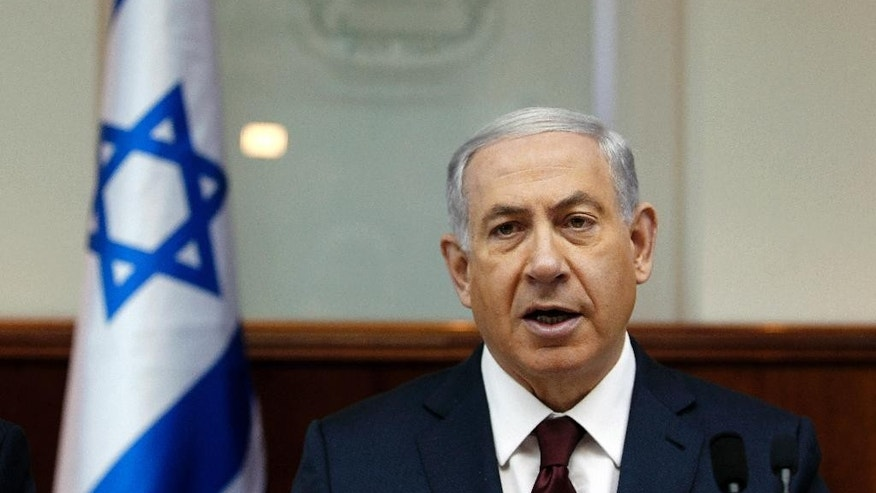Israel's Prime Minister Benjamin Netanyahu chairs the weekly cabinet meeting in Jerusalem, Sunday, Nov. 2, 2014. Jerusalem, at the center of the Israeli-Palestinian conflict, has been edging toward a new conflagration, with politicians on both sides stoking religious fervor over an ancient Jerusalem shrine sacred to Muslims and Jews. After months of escalating violence, Netanyahu on Sunday made his clearest attempt yet to cool tempers, saying he won't allow changes to a long-standing ban on Jewish worship at the Muslim-run site, despite such demands from ultra-nationalists in his coalition. (AP Photo/Ronen Zvulun, Pool)