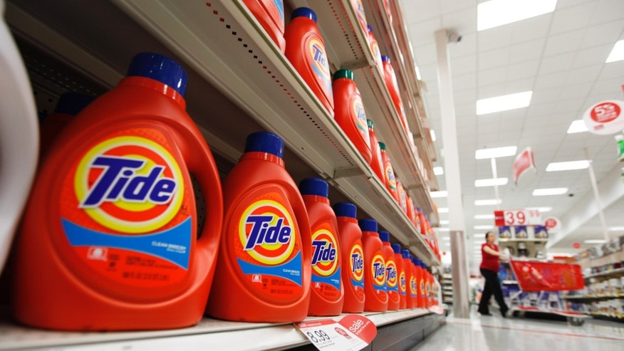 FILE - In this April 27, 2011 file photo, bottles of Procter & Gamble's Tide detergent are on display at a Target store in Richmond, Va.  Procter & Gamble Co. reports quarterly financial results on Friday, Oct. 24, 2014. (AP Photo/Steve Helber, File)