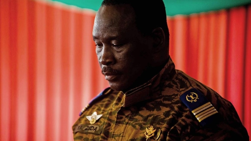 """Lt. Col. Issac Yacouba Zida, looks down during a press briefing in the city of Ouagadougou, Burkina Faso, Monday, Nov. 3, 2014. Burkina Faso's military says it will hand over to a transitional government under a leader chosen by all sectors of society, to fill the power vacuum since long-time president Blaise Compaore resigned and fled. Lt. Col. Isaac Yacouba Zida met with diplomats Monday and announced the country will be led by """"a transitional body within the constitutional framework."""" (AP Photo/Theo Renaut)"""