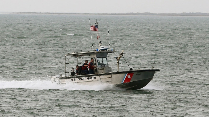 ATLANTIC, VA - OCTOBER 29: A U.S. Coast Guard boat patrols the waters near NASA's Wallops Flight Facility, October 29, 2014 in Atlantic, Virginia. An unmanned Orbital Sciences Corporation Antares commercial rocket headed for the International Space Station to deliver supplies exploded into a massive fireball in the early evening of October 28, seconds after lifting off from the launch pad at NASA's Wallops Island Flight Facility.  (Photo by Mark Wilson/Getty Images)