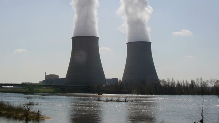 March 27, 2007:This file photo shows the Belleville-sur-Loire's nuclear plant, across the Loire river, central France. French security chiefs are investigating a spate of mysterious and illegal overflights of French nuclear power stations by tiny, unmanned drones. A government official told The Associated Press that authorities have counted about 15 drone flights over a half-dozen nuclear sites since Oct. 1