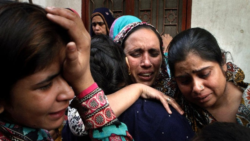 Pakistani women mourn for their family member who was killed in a Sunday suicide bombing, in Lahore, Pakistan, Monday, Nov. 3, 2014. The suicide bomber detonated explosives close to a Pakistani paramilitary checkpoint near the country's eastern border with India, that killed more than 50 people in the deadliest attack to hit the country in several months, police and government officers said. (AP Photo/K.M. Chaudary)