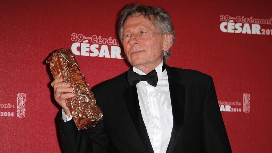 FILE - In this Feb. 28, 2014 file photo Polish-French film director Roman Polanski holds his best director award during the 39th French Cesar Awards Ceremony in Paris, Friday Feb. 28, 2014. Prosecutors in Poland questioned filmmaker Roman Polanski on the request of U.S. prosecutors who are seeking his arrest on charges from 1977 of having sex with a minor, a spokeswoman said Thursday, Oct. 30, 2014. Spokeswoman for the prosecutors in Krakow, Boguslawa Marcinkowska, said the filmmaker remained free but available for further proceedings. (AP Photo/Lionel Cironneau, File)