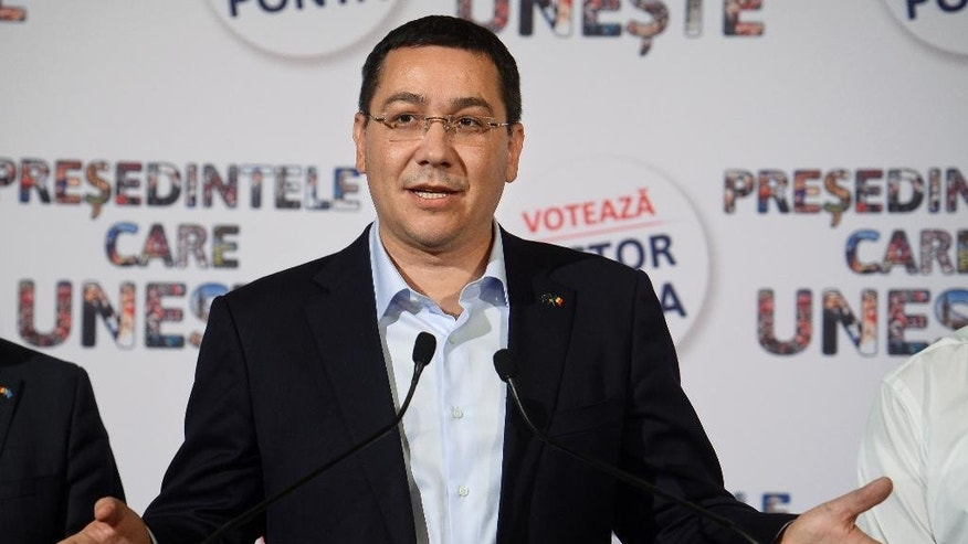 Romanian Prime Minister and presidential candidate of the ruling Social Democracy Party (PSD), Victor Ponta, gestures during a media conference following the presidential elections in Bucharest, Romania, Sunday, Nov. 2, 2014. Romanians are voting Sunday to elect a new leader as President Traian Basescu steps down after 10 years, with the prime minister favored to win in the nation of 19 million. (AP Photo/Octav Ganea, Mediafax) ROMANIA OUT