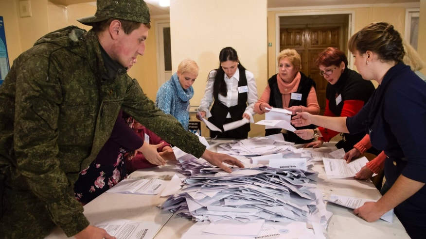 Nov. 2, 2014: Election officials count the votes during rebel elections at a polling station in the city of Donetsk, eastern Ukraine