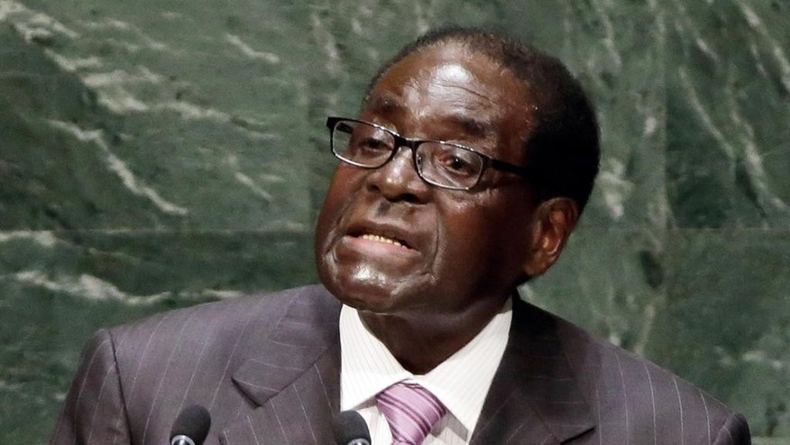 FILE -  In this Thursday Sept. 25, 2014 file photo Zimbabwean president Robert Mugabe, addresses the 69th session of the United Nations General Assembly, at U.N. headquarters. Mugabe, who has ruled since 1980, last year organized constitutional changes limiting a president to to two five-year terms, but only for a successor and not applied retroactively to ensure he can be an old-style life president. (AP Photo/Richard Drew, File)