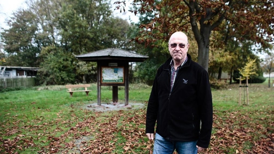 In this picture taken Oct. 29, 2014, Friedrich-Wilhelm Lenz stands at a site where the family owned a 75-acre farm in  Boeckwitz  Germany. It was 1952, and East German authorities were erecting the wooden barrier that broke up the twin towns of Zicherie in the capitalist West and Boeckwitz in the communist East. The two had operated as one for centuries, sharing markets, schools and social clubs, and had long been the site of the Lenz family farm. Nearly a decade before the Berlin Wall went up, East Germany had already started sealing off its main frontier with West Germany, spanning nearly 1,400 kilometers (870 miles), dividing communities and even families.. (AP Photo/Markus Schreiber)