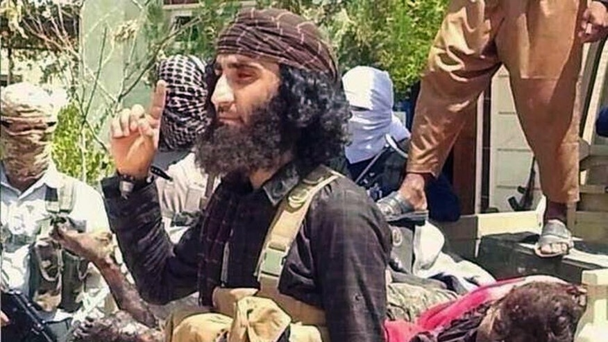 This undated image posted on a militant website shows Abu Khattab al-Kurdi, or Abu Khattab the Kurd, one of the Islamic State group's top military commanders in the offensive on the Syrian city of Kobani. Ethnic Kurds are helping members of the Islamic State group in the battle for the key Syrian Kurdish town of Kobani, sharing their knowledge of the local terrain and language with the extremists, according to Iraqi and Kurdish officials. Still, most Kurds are moderate and secular-leaning Muslims. (AP Photo/Jihadis website)