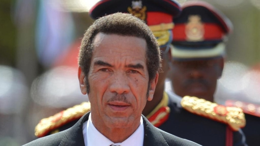 FILE -  In this Tuesday, Oct. 28 2014, President of Botswana Ian Khama attends a swearing-in ceremony for a second and final term as Botswana president at the National Assembly buildings in Gaborone, Botswana.   Opposition parties in Botswana say the president is undermining the role of parliament after he challenged the process of electing a vice president.   (AP Photo)