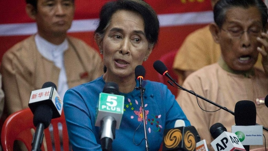 Myanmar Opposition Leader Aung San Suu Kyi speaks during a press conference at National League for Democracy party headquarters Wednesday, Nov 5, 2014, in Yangon, Myanmar. Suu Kyi has a message for President Barack Obama and other world leaders as they head to Myanmar: The international community's faith in its military-dominated government came too early and too fast, and democratic reforms stalled long ago. (AP Photo/Khin Maung Win)