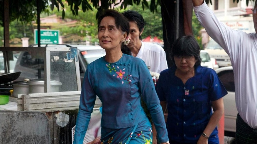 Myanmar Opposition Leader Aung San Suu Kyi arrives for a press conference at National League for Democracy party headquarters Wednesday, Nov 5, 2014, in Yangon, Myanmar. Suu Kyi has a message for President Barack Obama and other world leaders as they head to Myanmar: The international community's faith in its military-dominated government came too early and too fast, and democratic reforms stalled long ago. (AP Photo/Khin Maung Win)