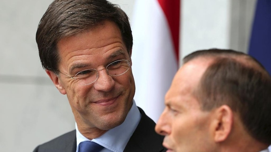Dutch Prime Minister Mark Rutte, left, address the media with Australia's Prime Minister Tony Abbott during a joint press conference at parliament house in Canberra, Australia, Thursday, Nov. 6, 2014. (AP Photo/Rob Griffith)