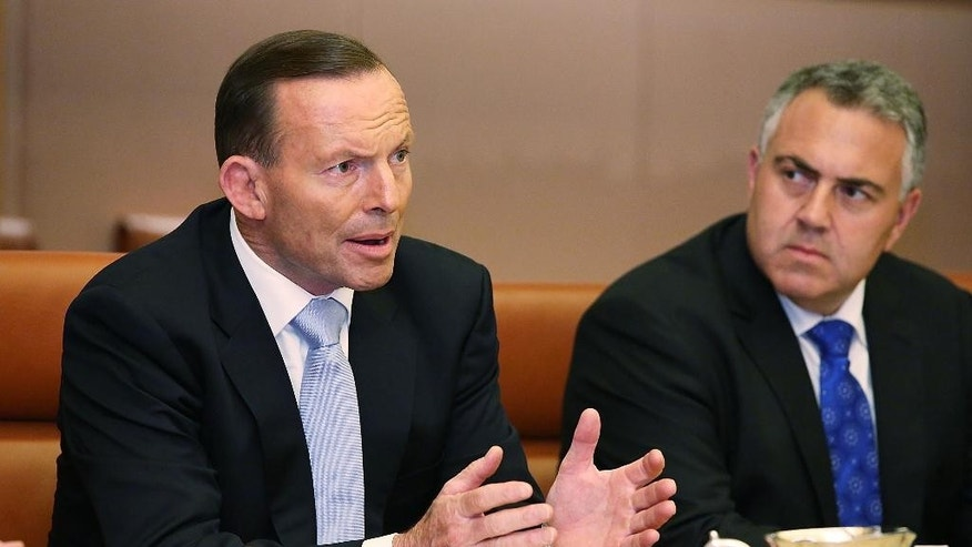 Australian Prime Minister Tony Abbott, left, talks with Dutch Prime Minister Mark Rutte, unseen, during a meeting at parliament house in Canberra, Australia Thursday, Nov. 6, 2014. (AP Photo/Stefan Postles, Pool)
