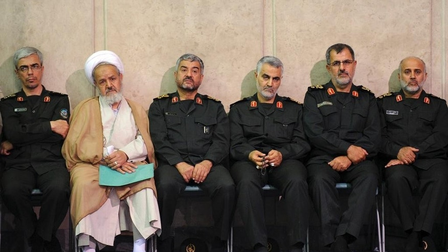 FILE - In this Tuesday, July 4, 2011 photo released by the official website of the office of the Iranian supreme leader, then chief of Iran's Revolutionary Guard's Quds Force Gen. Ghasem Soleimani, third right, sits next to the commander of the Revolutionary Guard, Mohammad Ali Jafari, third left, in a meeting of the commanders of the Revolutionary Guard with Supreme Leader Ayatollah Ali Khamenei in Tehran, Iran. Gen. Soleimani, a powerful Iranian general, has emerged as the chief tactician in Iraqís fight against Sunni militants, working on the front lines alongside 120 advisers from his countryís Revolutionary Guard to direct Shiite militiamen and government forces in the smallest details of battle, militia commanders and government officials say. (AP Photo/Office of the Iranian Supreme Leader, File)