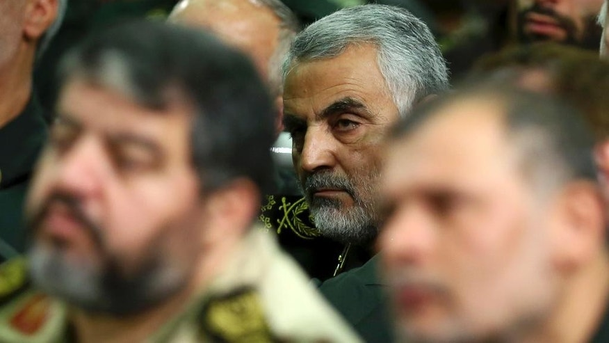 FILE - In this Tuesday, Sept. 17, 2013 file photo released by an official website of the office of the Iranian supreme leader, then chief of the Quds Force of Iran's Revolutionary Guard, Ghasem Soleimani, attends a meeting of the commanders of the Revolutionary Guard with Supreme Leader Ayatollah Ali Khamenei in Tehran, Iran. The powerful Iranian general Ghasem Soleimani whose name has become synonymous with the handful of victories attributed to Iraqi ground forces. Soleimani's ability to command the loyalty of Iraq's various Shiite militias has become a major factor in securing the area around the capital known as the Baghdad Belt, including a number of Sunni towns that were preyed upon by the extremist group. (AP Photo/Office of the Iranian Supreme Leader, File)