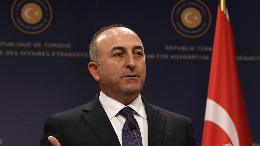 Turkish Foreign Minister Mevlut Cavusoglu speaks to the media during a news conference with his Iraqi counterpart Ibrahim al-Jafari, in Ankara, Turkey, Wednesday, Nov. 5, 2014.(AP Photo/Burhan Ozbilici)