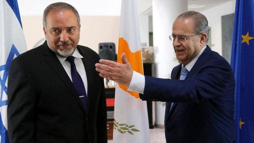 Israeli Foreign Minister Avigdor Liberman, left, meets Cyprus' Foreign Minister Ioannis Kasoulides, right, at the Foreign house in Nicosia, Cyprus, Wednesday, Nov. 5, 2014. Liberman is in Cyprus for two-days official visit. (AP Photo/Petros Karadjias)