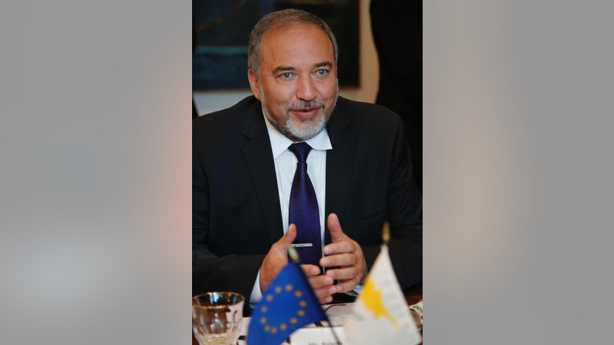 Israeli Foreign Minister Avigdor Liberman, speaks with with Cyprus' Foreign Minister Ioannis Kasoulides during their meeting in Nicosia, Cyprus, Wednesday, Nov. 5, 2014. Liberman is in Cyprus for two-days official visit. (AP Photo/Petros Karadjias)