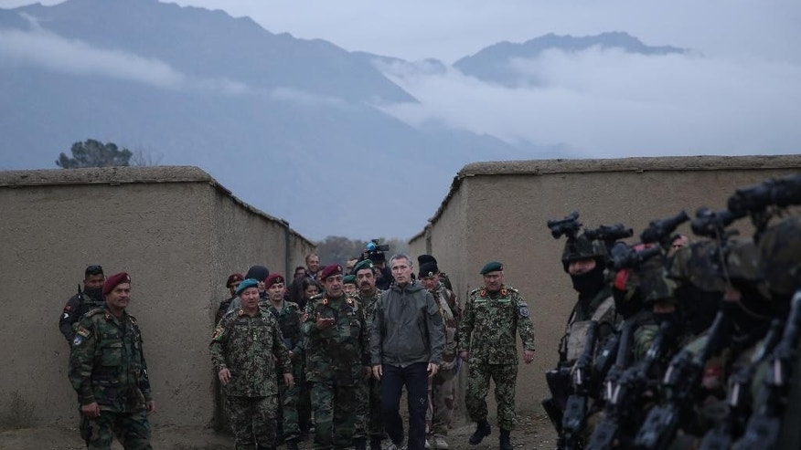 Secretary General of NATO, Jens Stoltenberg, center, listens to an Afghan National Army general during his first visit as head of NATO at the special forces training camp, in Kabul, Afghanistan, Thursday, Nov. 6, 2014.  (AP Photo/Massoud Hossaini)
