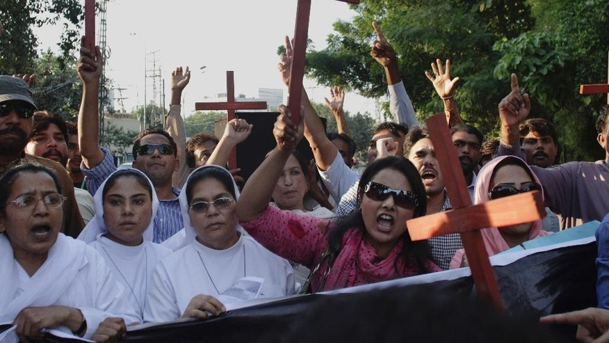 Pakistani Christians chant slogans to condemn the killing of a Christian couple during a demonstration in Lahore, Pakistan, Wednesday, Nov. 5, 2014. Police in Pakistan said Tuesday a Muslim mob has beaten to death a Christian couple and burned their bodies in a brick kiln where they worked over them allegedly desecrating the Quran. (AP Photo/K.M. Chuadary)