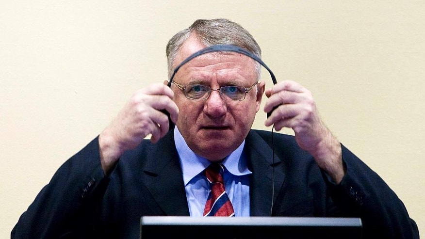 "FILE - In this March 6, 2009 file photo Serbian ultranationalist leader Vojislav Seselj seen in court at the International Criminal Tribunal for the former Yugoslavia (ICTY) in The Hague, Netherlands.  The Yugoslav war crimes tribunal is considering temporarily releasing an ailing Serb ultranationalist who is awaiting verdicts in his trial for allegedly using hate-laced speeches to incite atrocities in Bosnia and Croatia. Serbian doctors who visited Vojislav Seselj recently say he is suffering from colon cancer that has spread to his liver. The United Nations court has not released details of Seselj's health. In a filing released Wednesday, Nov. 5, 2014  the presiding judge in Seselj's long-running trial says that ""to avoid the worst-case scenario, the Chamber is examining the possibility of provisional release that would allow the Accused to receive treatment in the most suitable environment."" (AP Photo/Valerie Kuypers, Pool, File)"
