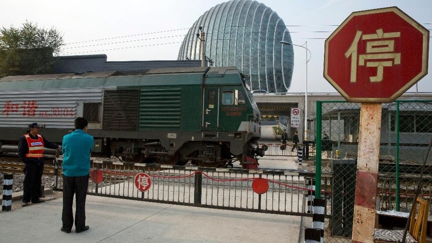 "In this photo taken Wednesday, Oct. 29, 2014, a train with the words reading ""Harmony"" on its side runs past a hotel used as the venue for the upcoming APEC summit in the Huairou district of Beijing, China. China plans to use a meeting of Asia-Pacific leaders to promote a regional trade initiative at a time when progress on a rival U.S.-led trade deal has stalled, injecting a note of rivalry into the annual summit. (AP Photo/Ng Han Guan)"
