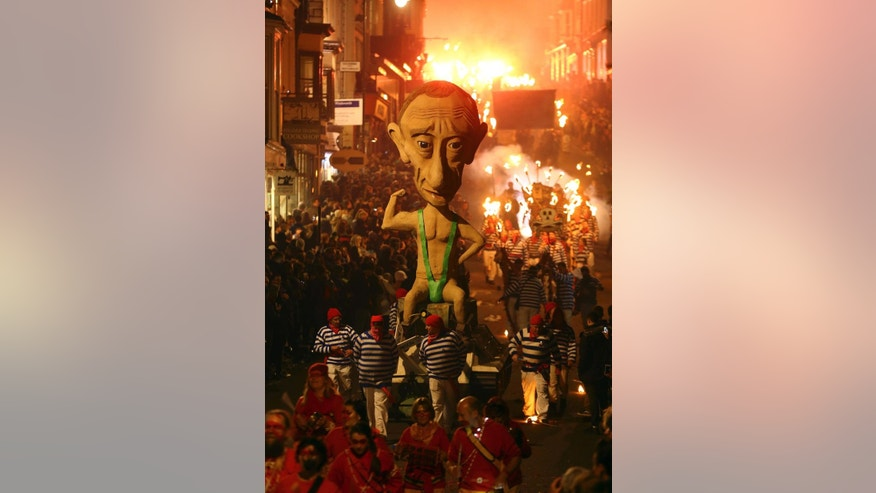 An effigy of Russian President Vladimir Putin is paraded through the town of Lewes, England, where an annual bonfire night procession is held by the Lewes Bonfire Societies, Wednesday Nov. 5, 2014. (AP Photo / Gareth Fuller, PA) UNITED KINGDOM OUT - NO SALES - NO ARCHIVES
