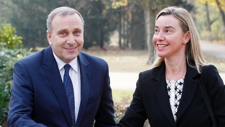 Polish Foreign Minister Grzegorz Schetyna, left,welcomes High Representative of the EU for Foreign Affairs and Security Policy, Federica Mogherini,right, prior to their meeting in Warsaw, Poland, Thursday, Nov. 6, 2014.. Mogherini arrives in Warsaw on her first official visit to an EU country after taking office on Nov.  1. (AP Photo/Czarek Sokolowski)