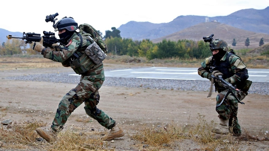 Nov. 6, 2014: Afghan special forces demonstrate their skills during the Secretary General of NATO, Jens Stoltenberg's first visit as head of NATO at the special forces training camp