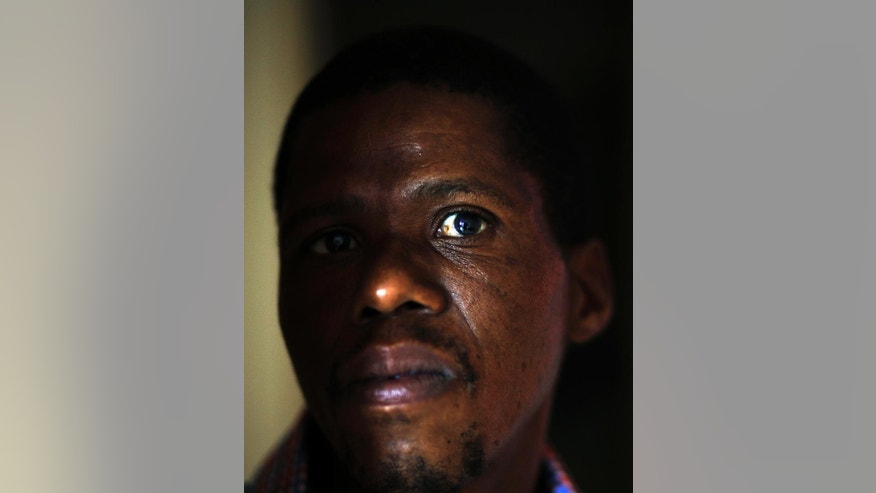 In this photo taken Thursday Nov. 6, 2014 Botswana journalist Edgar Tsimane, is photographed at his home in Pretoria, South Africa. Tsimane says he faces danger if he returns to his home country of Botswana, where the government has criticized his reporting. The government in Botswana says it isn't out to get him and he can return anytime from South Africa, where he has sought asylum. (AP Photo/Themba Hadebe)