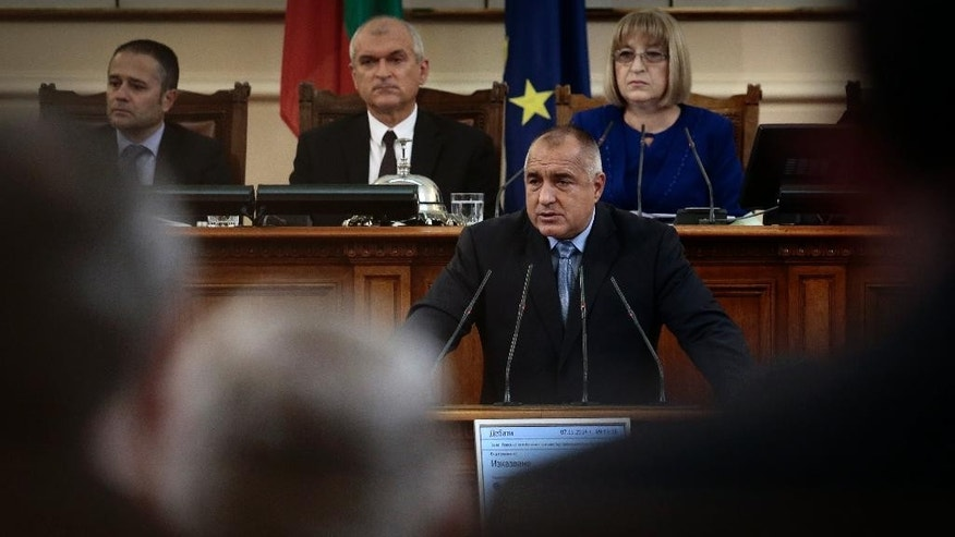 The new Bulgarian Prime Minister Boyko Borissov speaks in the parliament hall as his new government is approved by lawmakers in Sofia, Friday, Nov. 07, 2014. The former Sofia mayor, whose GERB party won a Oct. 5 election, was prime minister between 2009 and February 2013 when he stepped down amid nationwide social protests that have turned violent. Borisov is the first politician in Bulgaria's recent history to have a second term in office as Prime Minister. (AP Photo/Valentina Petrova)