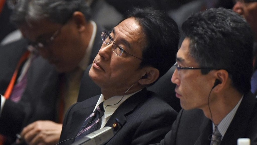 Japan's Foreign Minister Fumio Kishida, center,  listens at the start of Asia-Pacific Economic Cooperation (APEC) Summit ministerial meetings at the China National Convention Centre (CNCC) in Beijing Friday, Nov. 7, 2014. (AP Photo/Greg Baker, Pool)