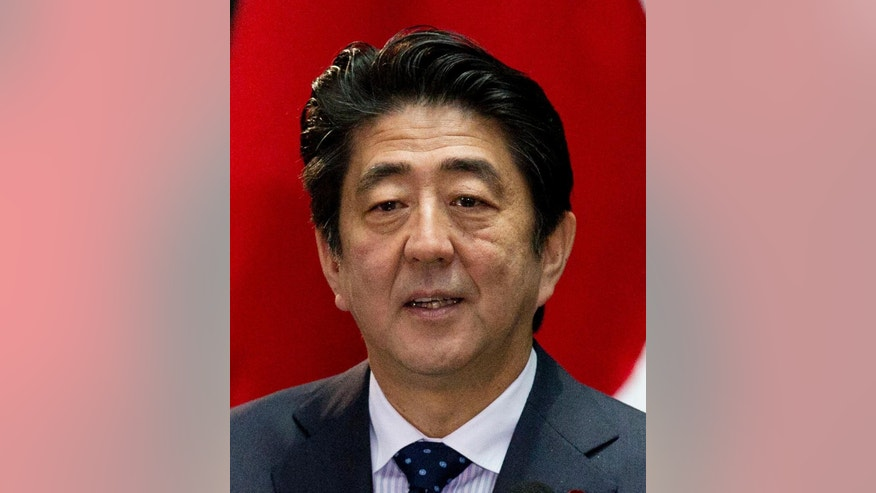FILE - In this July 25, 2014 file photo, Japanese Prime Minister Shinzo Abe addresses Mexican and Japanese press as well as dignitaries at the National Palace in Mexico City, Mexico. China said Friday, Nov. 7, it reached agreement with Japan to ramp up high-level contacts, the strongest indication yet of a possible meeting between Chinese President Xi Jinping and Abe at next week's Asia-Pacific Economic Cooperation summit in Beijing. (AP Photo/Rebecca Blackwell, File)