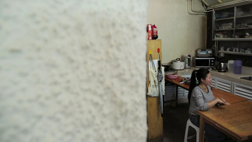 A Filipino domestic worker, who asked to be identified only by her first name, Babylen, speaks during an interview with The Associated Press at a shelter opened for unemployed domestic workers in Hong Kong Friday, Nov. 7, 2014. More than 160,000 Indonesians, almost all women, have taken similarly perilous routes to jobs as maids, nannies and housekeepers in Hong Kong, lured by salaries as much as five times higher than at home. Now, they're mourning two of their own Seneng Mujiasih and Sumarti Ningsih, former domestic workers in their 20s who were found stabbed to death last weekend in the luxury apartment of British investment banker Rurik George Caton Jutting. For Babylen the past year and a half in Hong Kong has been a bitter disappointment. An injury on the job led to her dismissal in March. Now, she's waiting to receive compensation while sleeping in the shelter. (AP Photo/Vincent Yu)